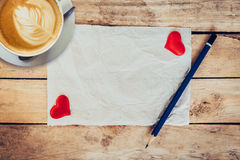 Old paper and red heart, coffee cup with pencil  Stock Images