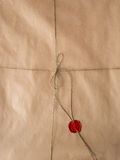 Old paper with red wax seal and twine Stock Photography