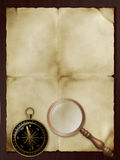 Old paper, retro magnifier and compass Royalty Free Stock Photos