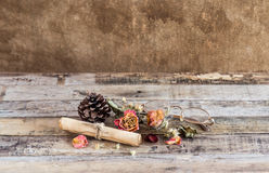 Old paper roll, glasses,and dry rose on wooden background Stock Photography