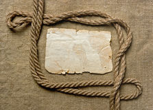Old paper and rope on canvas Royalty Free Stock Photo