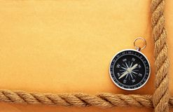 Old paper, rope and compass Stock Photos