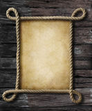 Old paper in rope pirate style frame Stock Image