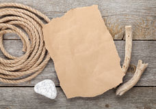 Old paper and rope on wooden textured background Stock Photos