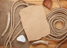 Old paper and rope on wooden textured background Royalty Free Stock Image