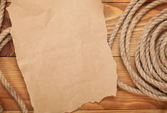 Old paper and rope on wooden textured background Stock Photo