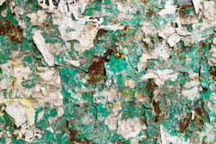 Old Paper and Rust Covered Advertising Board Royalty Free Stock Photography