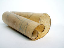 Old paper scroll. Old vintage paper scroll rolled on white