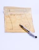 Old paper scroll diploma. Open with pen, ready to be written royalty free stock photos