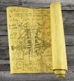 Old paper scroll with human throat, mechanical parts and formulas Royalty Free Stock Image