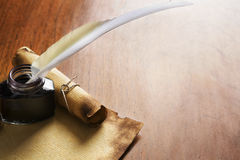 Old paper, scroll and quill pen on wooden paper Royalty Free Stock Photography
