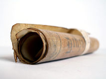 Old paper scroll rolled. Old vintage paper scroll rolled on white Stock Photos