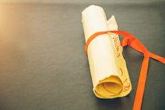 Old paper scroll. On wooden background close-up Royalty Free Stock Photo
