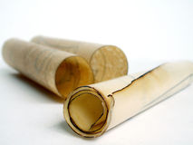 Old paper scrolls. Old vintage paper scrolls rolled on white Royalty Free Stock Photo