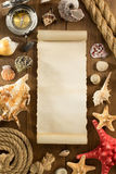 Old paper and seashell on wooden background Stock Images