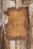 Old paper sheet. Over wooden background royalty free stock images