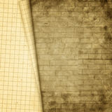 Old paper sheet on background of wall Royalty Free Stock Images