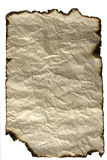 Old paper sheet with burned edges. Old manuscript background - vintage rumpled burnt paper isolated on white Stock Photos