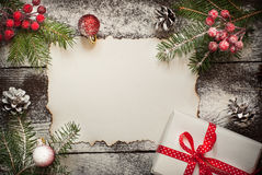 Old paper sheet with  christmas decorations. Royalty Free Stock Photography