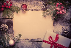 Old paper sheet with  christmas decorations. Stock Photos