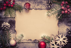 Old paper sheet with  christmas decorations. Royalty Free Stock Image
