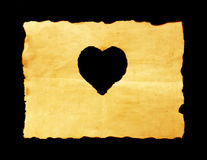 Old paper sheet with heart symbol on black background Royalty Free Stock Image