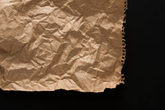 Old paper sheet isolated on black background Stock Photo