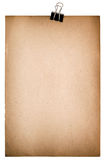Old paper sheet with metal clip. Grungy textured cardboard. Isolated on white background Royalty Free Stock Photo