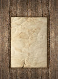 Old paper sheet over rustic wooden background Royalty Free Stock Images