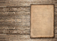 Old paper sheet over rustic wooden background. Grunge vintage backdrop Royalty Free Stock Photos