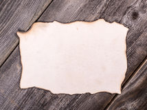 Old paper sheet over wooden background Stock Photos