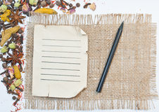 Old paper sheet, pencil and spices. On old cloth isolated on white background Royalty Free Stock Images