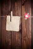 Old paper sheet and small paper heart Stock Image