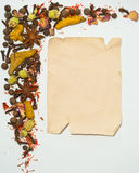 Old paper sheet and spices Stock Photography