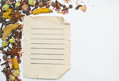 Old paper sheet and spices. On white background Royalty Free Stock Image