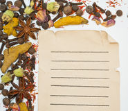 Old paper sheet and spices on white background. Old paper sheet and spices isolated on white background Stock Images