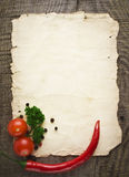 Old paper sheet and vegetables. For a menu or recipe Royalty Free Stock Images