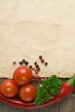 Old paper sheet and vegetables. For a menu or recipe Stock Photo