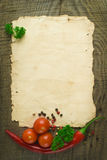 Old paper sheet and vegetables. For a menu or recipe Stock Photos