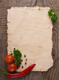 Old paper sheet and vegetables. For a menu or recipe Royalty Free Stock Image