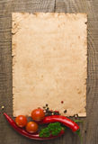 Old paper sheet and vegetables. For a menu or recipe Stock Image