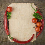 Old paper sheet and vegetables. For a menu or recipe Royalty Free Stock Photos