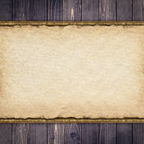 Old paper sheet on wooden background. Old paper sheet on old wooden background Royalty Free Stock Photo