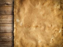 Old paper sheet on wooden background. Old stained paper sheet on wooden background Stock Photos