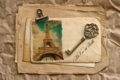 Old paper sheets with clip and vintage key. Old paper sheets with clip, vintage key and sample text La Vie est Belle Royalty Free Stock Photo