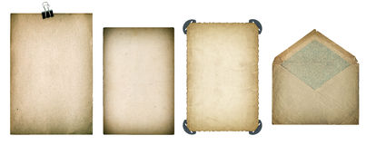 Old paper sheets and envelope. Grungy textured cardboard. Isolated on white background. Scrapbook elements. Vintage style toned Stock Images