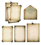 Old paper sheets and envelope. Grungy textured cardboard. Scrapb. Old paper sheets and envelope. Grungy textured cardboard isolated on white background Royalty Free Stock Photo