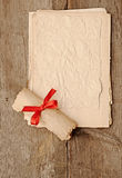 Old paper sheets with old paper roll Royalty Free Stock Photography