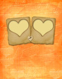 Old paper slides in the form of hearts Stock Images