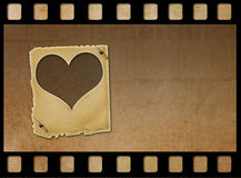 Old paper slides in the form of hearts on abstract background Stock Photo